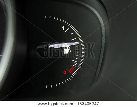 Close-up shot of a fuel gauge in a car