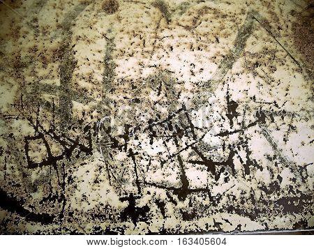 Fragmento de chapa oxidad con marcas y manchas