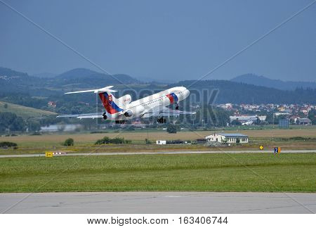 Sliac, Slovakia - August 27, 2011: Tupolev Tu-154 airplane of Slovak Government Flying Service takes off from runway