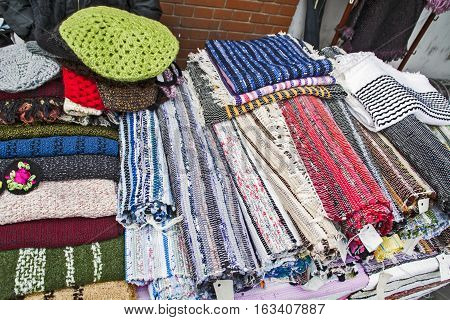 Of domestic hand-woven patchwork on a table.