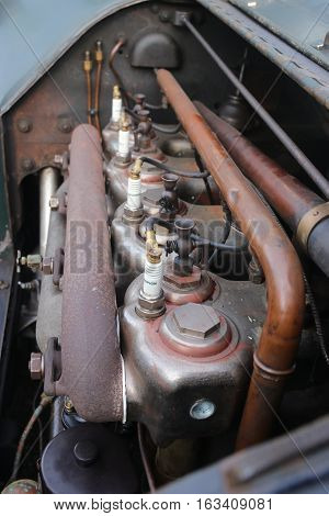 A close up of an old vintage four cylinder engine