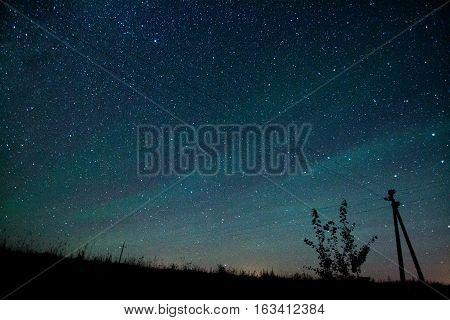 Starry night sky with aurora polaris Belarus august 2016