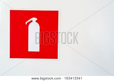 Fire extinguisher symbol in red and white squares
