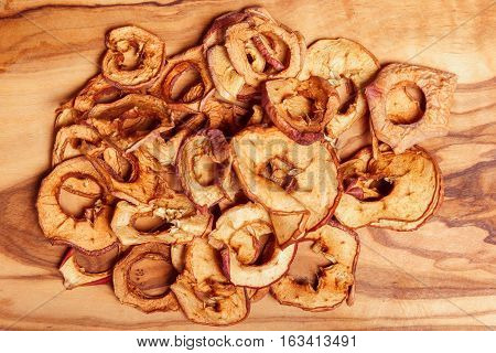 Dried fruits, apples, pear on wooden background