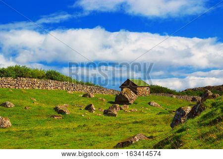 House On Stony Green Grass