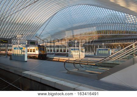 LIEGE, BELGIUM - MAR 29, 2014: The Liege-Guillemins railway station on August 5th, 2014 in Belgium. This station is made of steel, glass and white concrete designed by Spanish architect Santiago Calatrava.