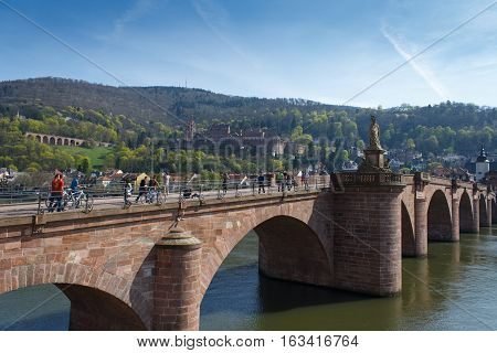 HEIDELBERG, GERMANY - MAR 29, 2014: The old bridge Alte Brucke across the river Neckar in the old german city Heidelberg. Monkey bridge.