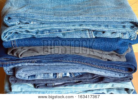 Many colored jeans on sale. Front view closeup