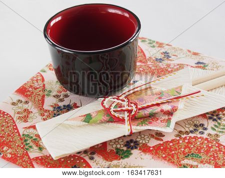 Sake(rice wine) cup and chopsticks bag for New Year, on the beautiful japanese paper
