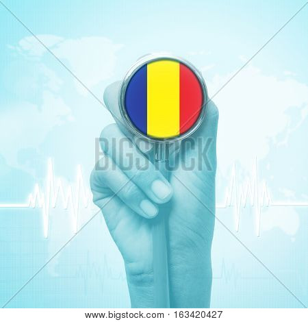 doctor hand holding stethoscope with Chad flag.