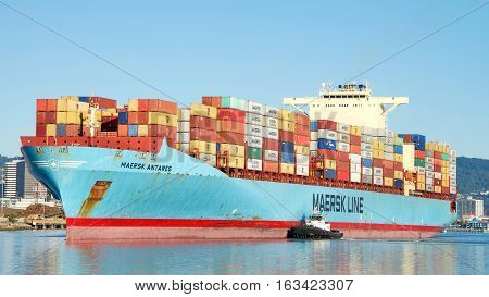 Oakland CA - December 28 2016: Cargo Ship MAERSK ANTARES entering the Port of Oakland the fifth busiest port in the United States.