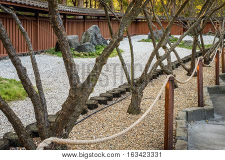 Sydney, Australia - May 22, 2016: At the popular Auburn Botanic Gardens, Japanese Zen Gardens section featuring the Ryoan-ji style designs. Zen garden beside footpath.
