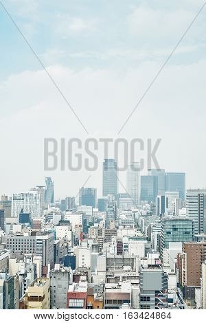 Business concept - panoramic modern city skyline bird eye aerial view with spiral tower and midland square under dramatic cloud and morning bright blue sky on Nagoya TV Tower in Nagoya Japan