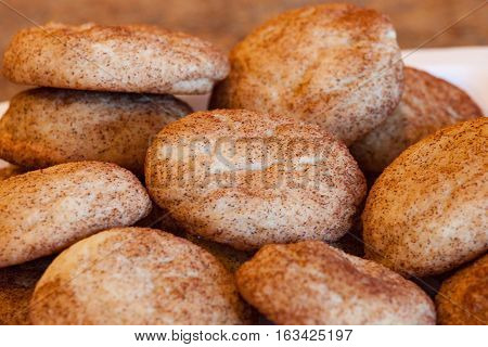 Plate with pile of freshly baked snickerdoodle cookies