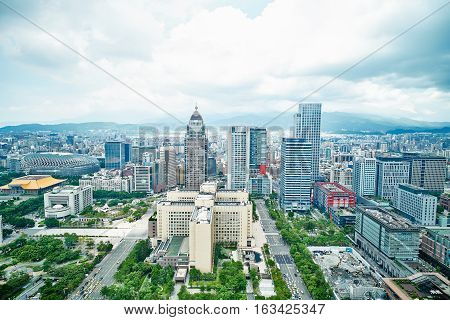 Business concept for real estate and corporate construction : panoramic modern city bird eye view with dramatic blue sky from 101 building in Taipei Taiwan