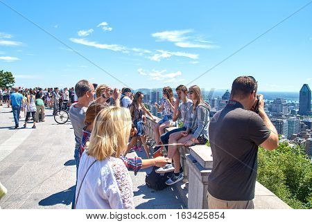 MONTREAL CANADA - AUGUST 23 2016 : Scenic view of downtown Montreal in summer and people taking pictures and making selfies.