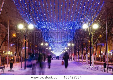 Beautiful city alley in winter. Night city lights