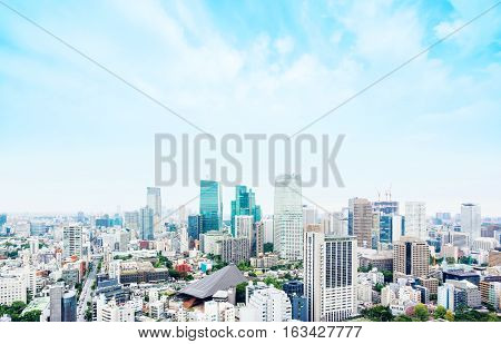 Business and culture concept - panoramic modern city skyline bird eye aerial view from tokyo tower under dramatic morning blue cloudy sky in Tokyo Japan