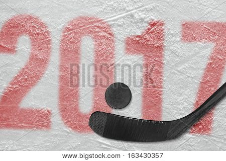 Hockey stick and puck on the ice stadium. Concept hockey season 2017