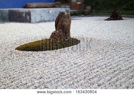 Zen gardens typically contain gravel and bare stones stock photo