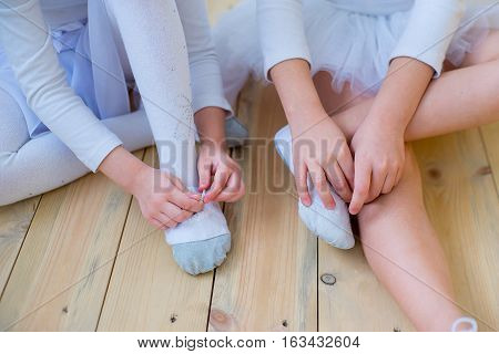 Two Young Ballet Dancers Preparing For Lesson