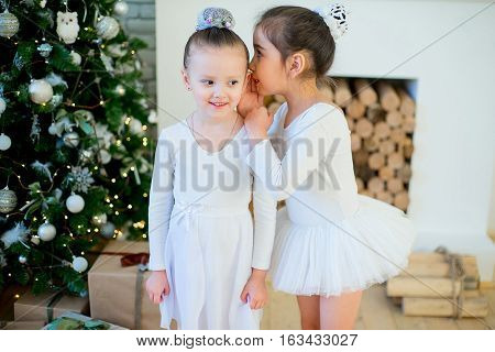 Two Young Ballet Dancer Standing Near Christmas Tree