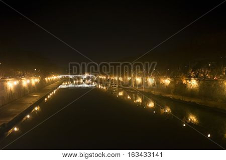 Tiber river by night in Rome with Its lit banks