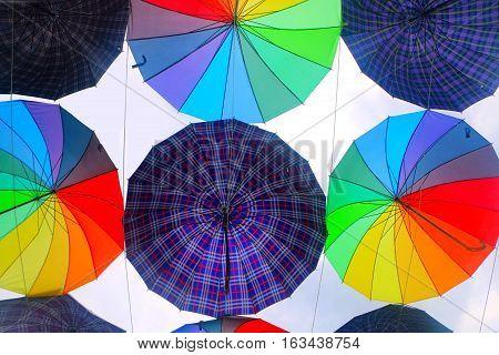 Colorful umbrella design pattern over white background