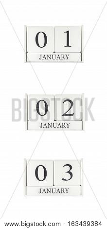 Closeup group of white wooden calendar with black 1 2 3 january word three date calendar isolated on white background