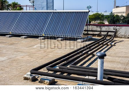 Vacuum solar cells for water heating system on the pool roof