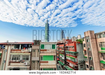 TAIPEI TAIWAN - NOVEMBER 11: This is a view of old apartment buildings in the Xiangshan area with Taipei 101 in the distance on November 11 2016 in Taipei