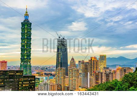 TAIPEI TAIWAN - NOVEMBER 18: View of Taipei financial district architecture and Taipei 101 building in the evening on November 18 2016 in Taipei