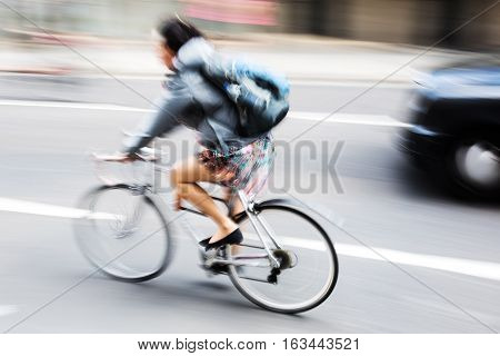 Woman With Bicycle In City Traffic