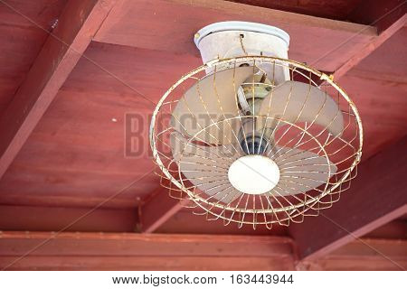 Old white electric Ceiling fan, indoors, wooden house.