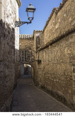 Medieval neighborhood in Baeza alleyway with stone arch Jaen province Andalusia Spain