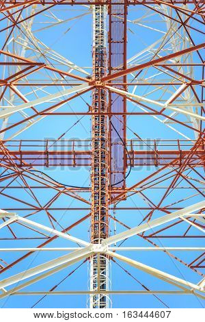 Closeup to Telecommunication tower with the blue sky.