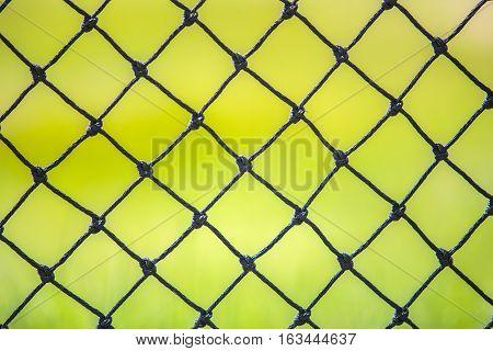 black net behind of football or soccer field in the stadium.