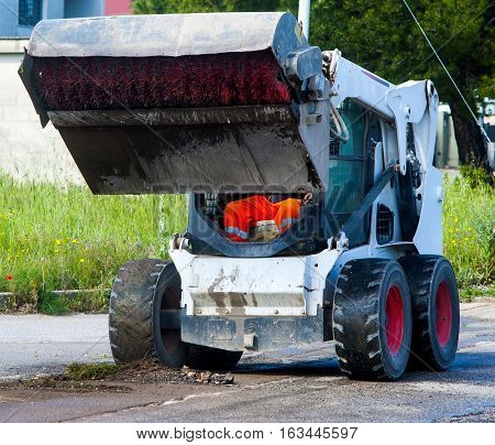 Sweeper attachments mini excavator on road maintenance