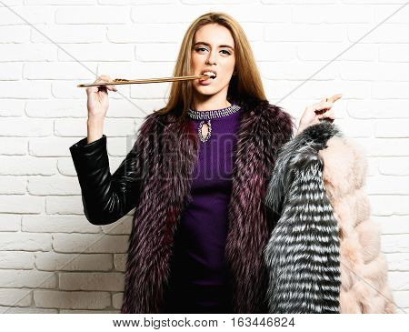 Serious Fashionable Woman In Fur