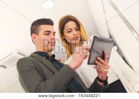 Two people are choosing digital tablet in the store