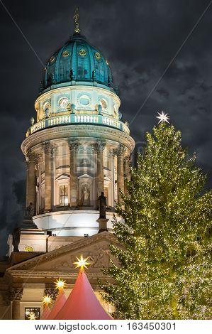 Deutscher Dom on Berlin Gendarmenmarkt with Christmas tree at night