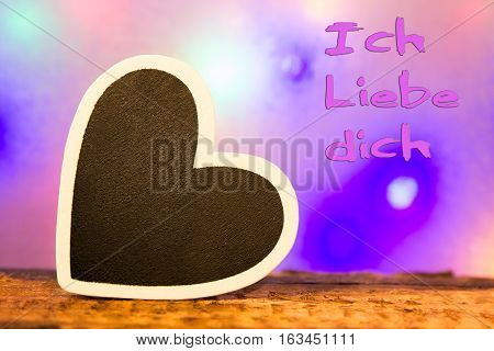 A black heart with a white border and the inscription Ich liebe dich (I love you in german)