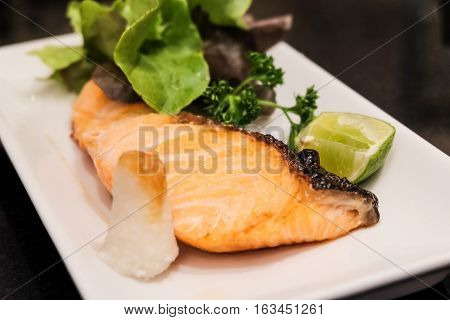 Grilled salmon steak Japanese food style in white disc