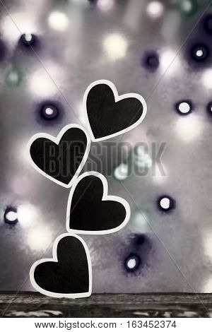 Four stacked hearts in black and white