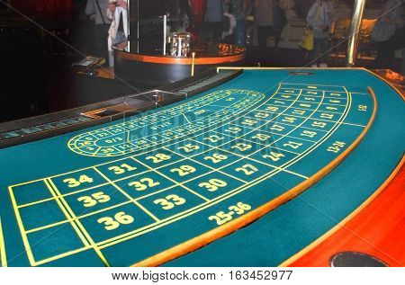 Casino. A table for the European roulette covered with green felt.