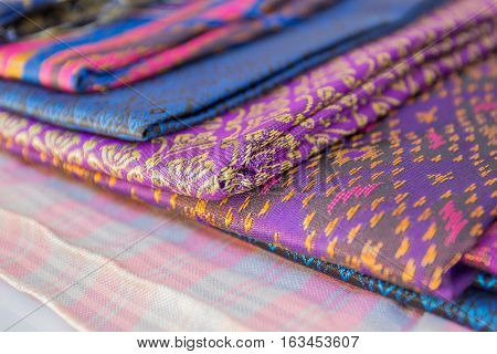 Thailand silk woven by hand which expresses the identity of the people of Thailand are placed overlapping various rashes.