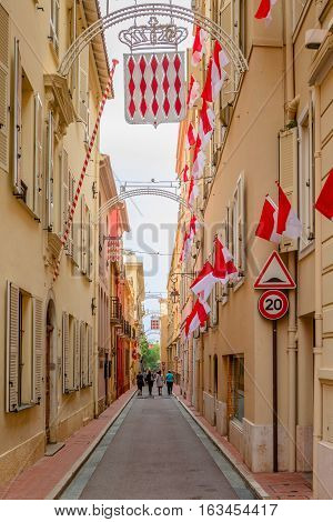 Monaco-Ville Monaco - November 4 2016: Tourists are walking on the narrow streets of Monaco-Ville.