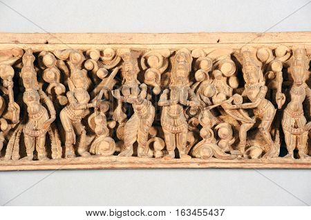 Antique indian wooden frieze isolated on grey