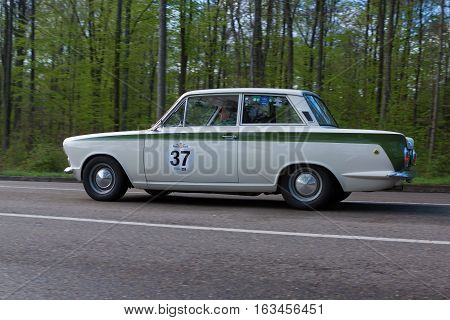 HEIDENHEIM GERMANY - MAY 4 2013: Manfred Krehle and Silvia Bogenrieder in their 1965 Ford Lotus Cortina at the ADAC Wurttemberg Historic Rallye 2013 on May 4 2013 in Heidenheim Germany.