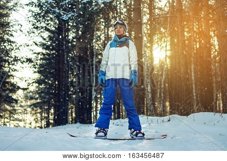 Female Snowboarder Snowboarding Down The Mountain